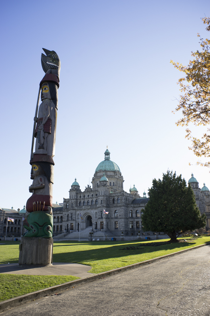 Totem pole in front of Parliament Buildings in Victoria, BC