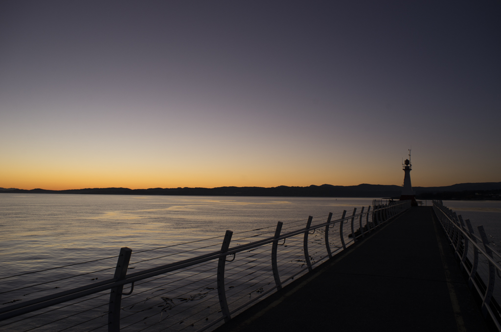 the Lighthouse during Sunset at The Breakwater at Victoria Harbour, BC